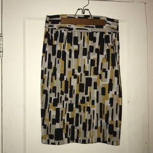 Midi skirt with gray, black and gold geo design.